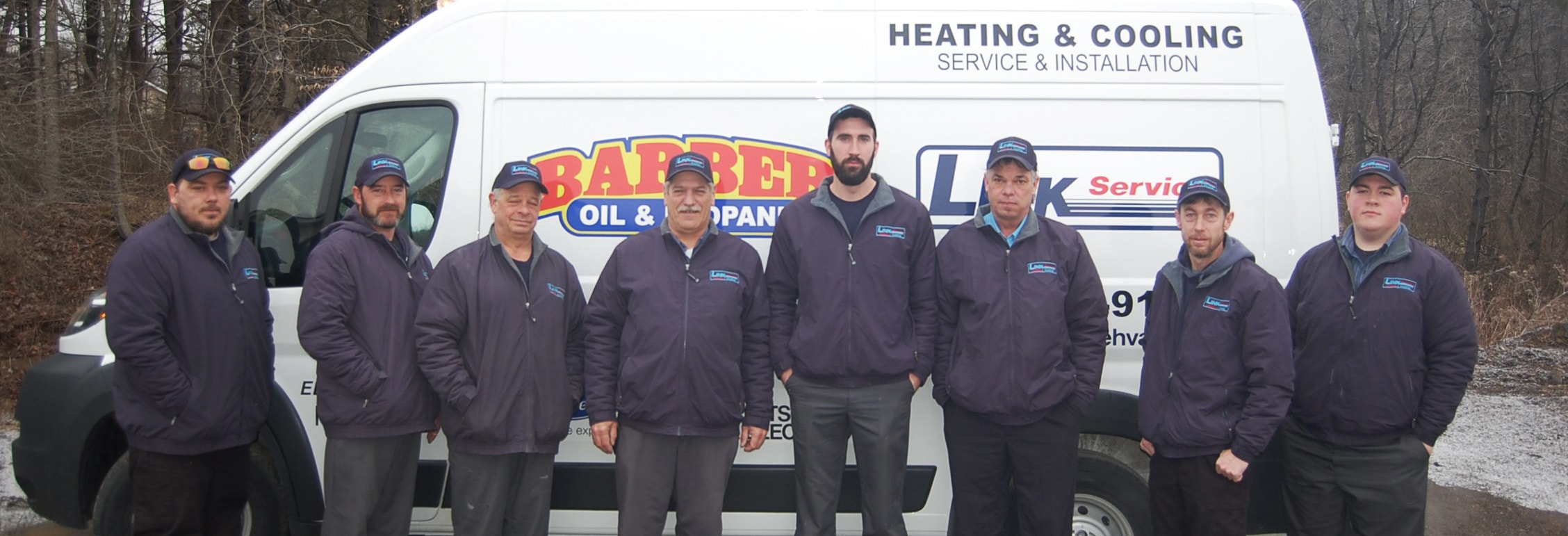 Link Heating and Cooling truck with technicians.